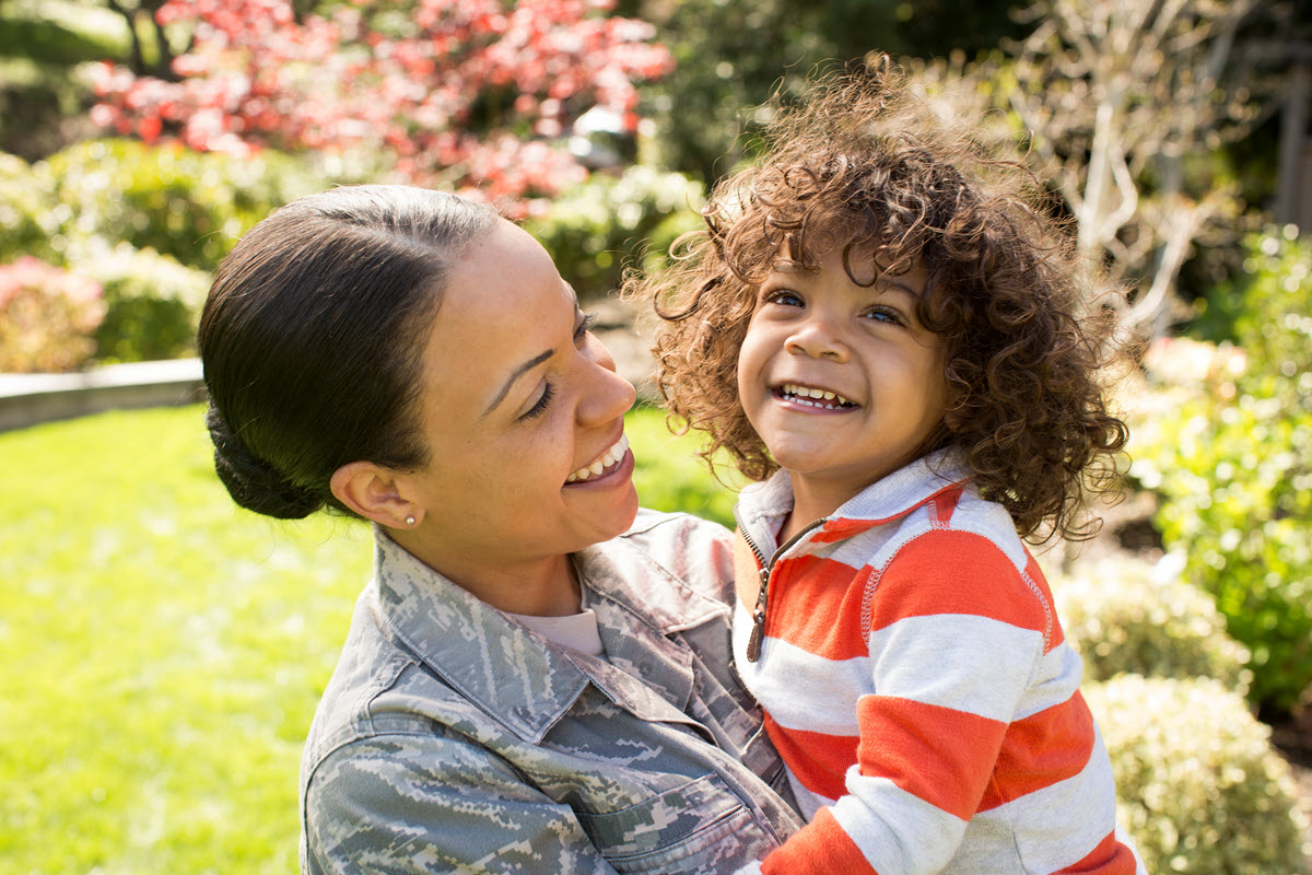 military mother and son smiling