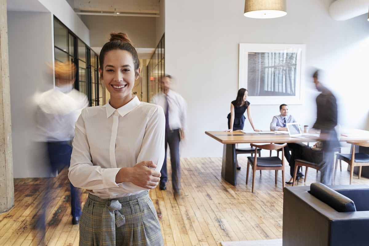 woman standing in an office smiling