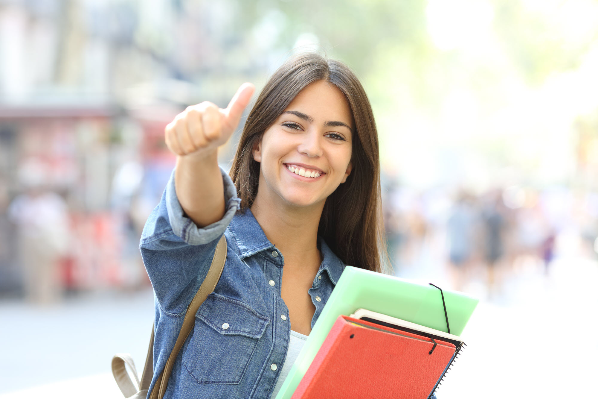 high school girl smiling with thumb up